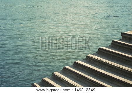 Stairs leading down into a blue water