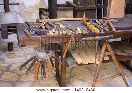 Vintage woodworking tools on a wooden workbench