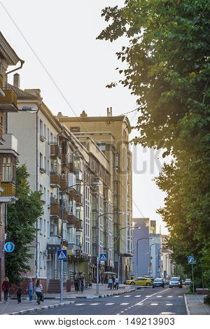 BELGOROD RUSSIA - SEPTEMBER 10 2016: Roadway Holy Trinity Boulevard in the center of Belgorod in the light of the low sun. Houses late Stalin era (mid 20th century) and modern buildings.