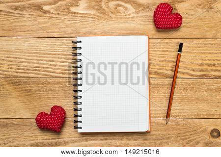 Blank paper sheet for writing on wooden table