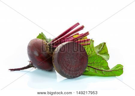 Red beets with leaves isolated on a white background