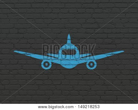 Travel concept: Painted blue Aircraft icon on Black Brick wall background