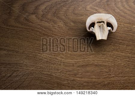 sliced tasty mushrooms on a wooden background