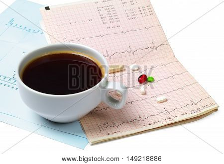 Cup of hot coffee electrocardiogram and pills