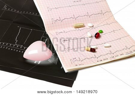 Black electrocardiogram tablets and heart on white background