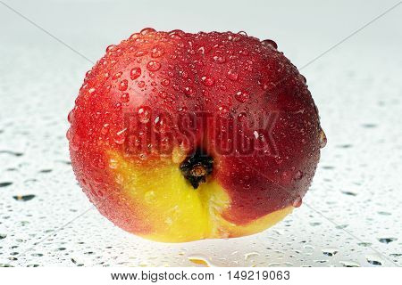 Fresh nectarine with water drops close up