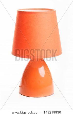 Orange table lamp isolated on white background.