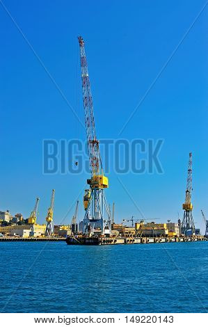 Cargo shipping, cranes in Genova sea industrial port, Italy