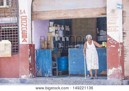 HAVANA CUBA - JULY 18 : A Cuban food seller in old Havana street on July 18 2016. The historic center of Havana is UNESCO World Heritage Site since 1982.