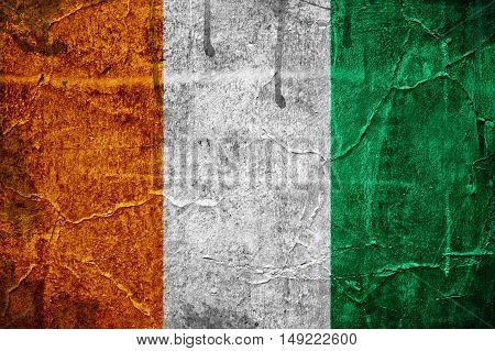 Flag of Ivory Coast overlaid with grunge texture