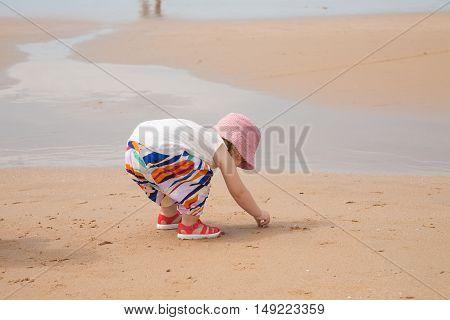 Baby Picking Sea Shells
