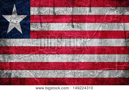 Flag of Liberia overlaid with grunge texture