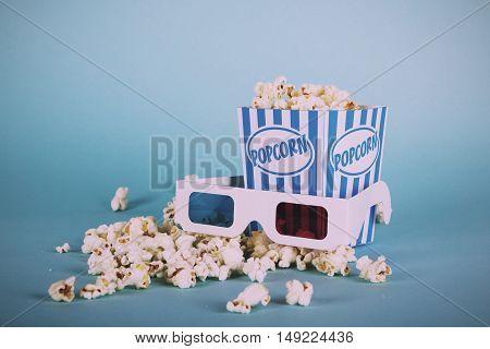 Popcorn Bucket Against A Blue Background Vintage Retro Filter.