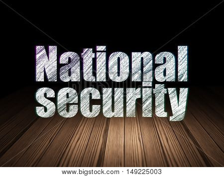 Protection concept: Glowing text National Security in grunge dark room with Wooden Floor, black background
