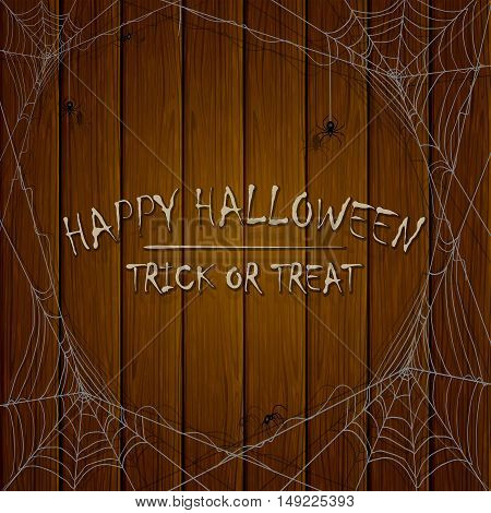Inscriptions Happy Halloween and trick or treat on wooden background, with cobwebs and black spiders, illustration.