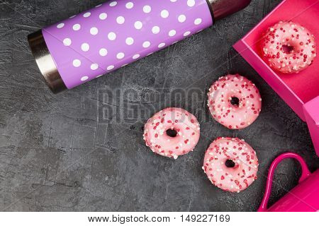 Tasty donuts on dark background