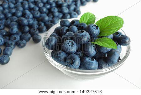 Blueberries cup healthy fresh summer antioxidant fruit background.