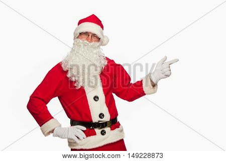 christmas Santa Claus pointing in white blank sign with smile, isolated on white background