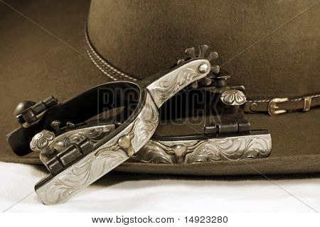Silver Spurs and a Cowboy Hat