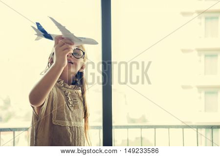 Girl Playing Plane Toy Concept