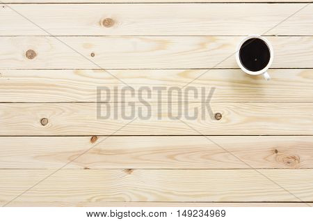 dark coffee in white cup on top view wood table with space for your place object or text