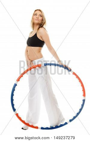 Sport training gym and lifestyle concept. Full length sporty girl doing exercise with hula hoop. Fitness woman isolated on white