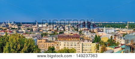 Picturesque view from Zamkova Hill of the National University Of Kyiv-Mohyla Academy, its territory and Havansky Bridge across the Dnieper river. Historical center of Kiev.