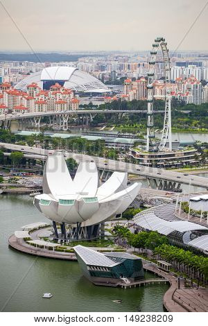 Singapore - June 24, 2016: View of central Singapore: Singapore Flyer, ArtScience museum and National stadium