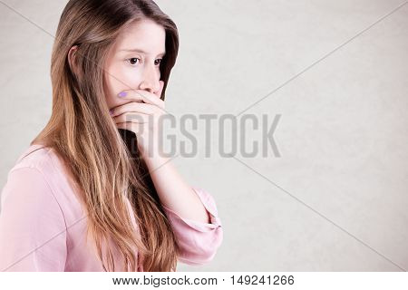 Concerned Woman Covering Mouth