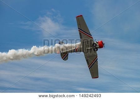 NEW WINDSOR NY - SEPTEMBER 3 2016: The GEICO Skytypers Air Show Team perform at the New York Airshow at Stewart Int Airport. SNJ-2 World War II era planes fly in formation.