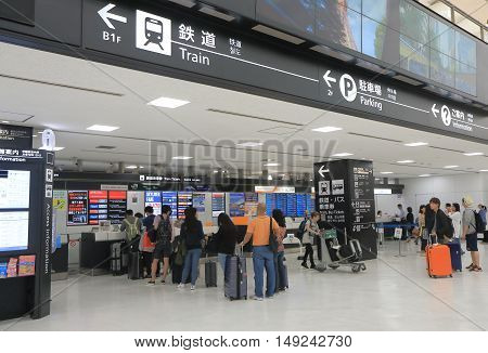 TOKYO JAPAN - SEPTEMBER 23, 2016: Unidentified people queue to buy train and bus tickets at Narita airport in Tokyo.