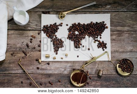 map of the world, lined with coffee beans on old paper.