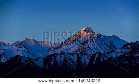 Himalayan mountain range during sunrise light morning.