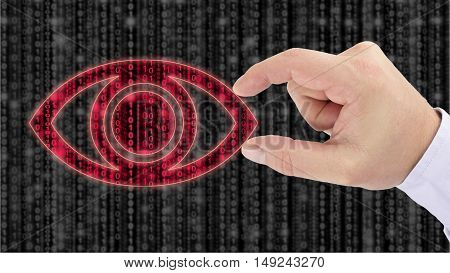 Hand holding an eye on top of a blurry grey digital matrix to uncover red datastreans data espionage concept