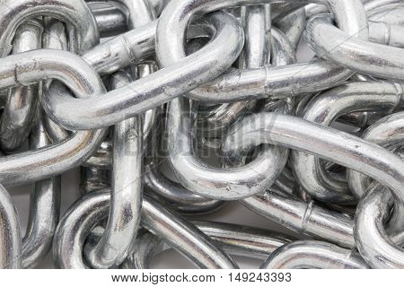 Silver shiny heavy metal chain closeyp background