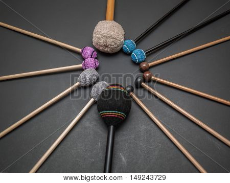 great amazing closeup view of drum and percussion orchestra natural hickory wood sticks on dark grey background