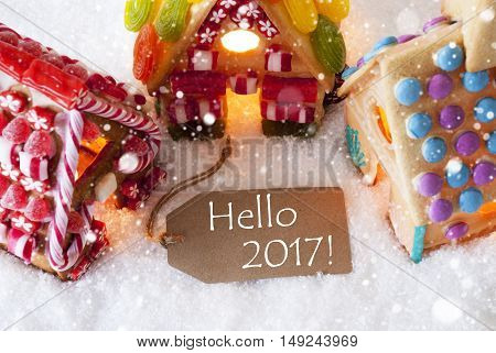 Label With English Text Hello 2017 For Happy New Year. Colorful Gingerbread House On Snow And Snowflakes. Christmas Card For Seasons Greetings
