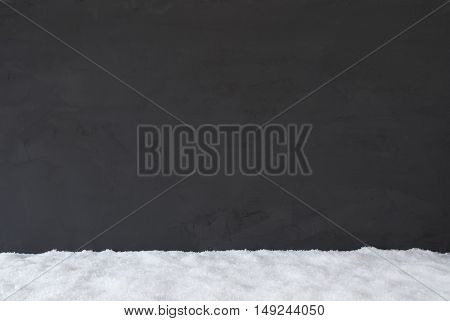 Black Cement Wall As Texture Or Background With White Snow. Copy Space For Advertisement.
