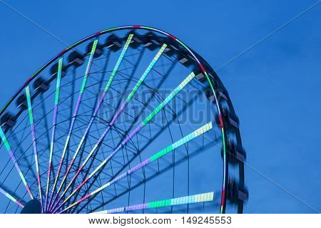 Low Angle View Of Silhouette Turning Ferris Wheel At Sunset