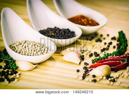 Spices and herbs on a wood background.