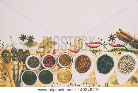 Spices and herbs on a white background with copy space.