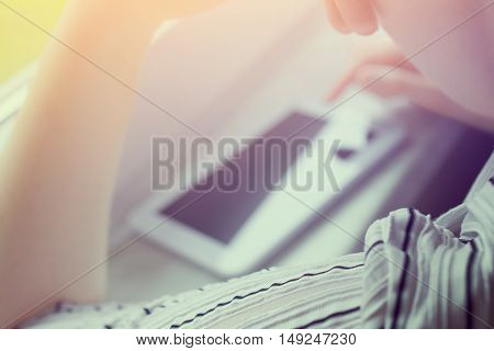 Woman Using White Business Tablet In Landscape View On Windowsill At Sunset