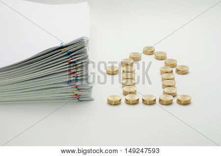 Pile of gold coins and pile overload paperwork of report with colorful paperclip on white background.