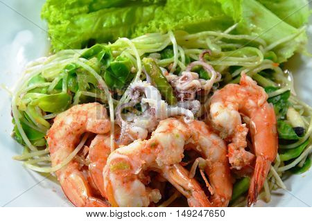 sunflower sprout with mixed seafood spicy salad on dish