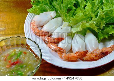 shrimp stuffed squid cocktail dipping with spicy and sour sauce