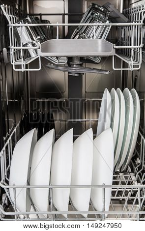 Dishes In A Modern Dishwasher Machine