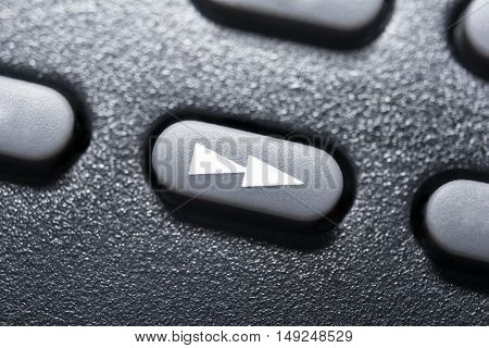 Macro Of A Black Fast Forward Button On Black Remote Control For A Hifi Stereo Audio System