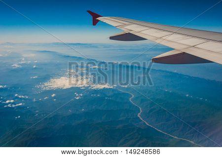 Bird eye view above Myanmar land by plane