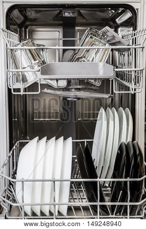 Clean Plates And Glasses In Dishwasher Machine