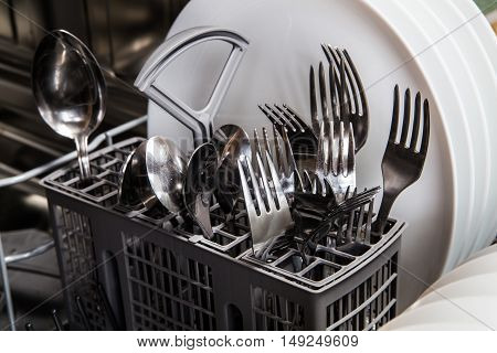 Steel Forks And Plates In Dishwasher Machine